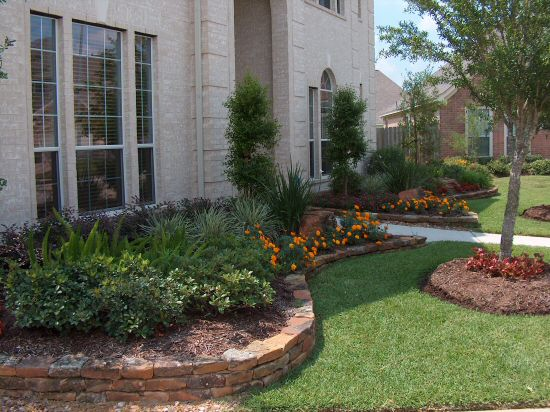 Bayside landscape services natural rock borders walls for Raised flower bed ideas front of house